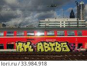 Frankfurt am Main, Germany, graffiti on a regional express train of Deutsche Bahn. Редакционное фото, агентство Caro Photoagency / Фотобанк Лори
