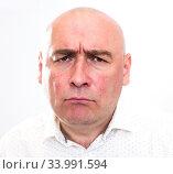 Купить «portrait of bald adult mature man with emotions on white background», фото № 33991594, снято 23 мая 2020 г. (c) Татьяна Яцевич / Фотобанк Лори