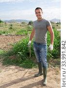 Portrait of amateur gardener proud of his garden. Стоковое фото, фотограф Яков Филимонов / Фотобанк Лори