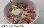 Купить «Healthy breakfast from natural organic ingredients granola and b», видеоролик № 33992246, снято 7 июля 2020 г. (c) Ярослав Данильченко / Фотобанк Лори