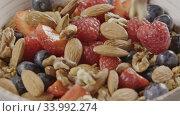 Купить «Cooking of healthy breakfast from falling granola, fresh organic», видеоролик № 33992274, снято 7 июля 2020 г. (c) Ярослав Данильченко / Фотобанк Лори