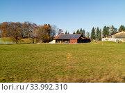 Купить «Farming lands and buildings with solar panels on the roof, Austria.», фото № 33992310, снято 11 ноября 2015 г. (c) Ярослав Данильченко / Фотобанк Лори