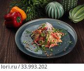 Купить «Asian rice noodles salad with chicken meat, tomatoes, sesame, radishes, nuts and greens», фото № 33993202, снято 2 мая 2019 г. (c) Алексей Кокорин / Фотобанк Лори