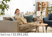 sad sick woman in blanket and scarf at home. Стоковое фото, фотограф Syda Productions / Фотобанк Лори