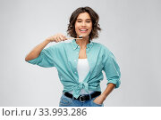 smiling woman with toothpaste on wooden toothbrush. Стоковое фото, фотограф Syda Productions / Фотобанк Лори