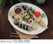Fresh and tasty sushi on the wooden table. Стоковое фото, фотограф Алексей Кокорин / Фотобанк Лори