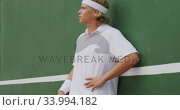 Tennis player against a wall. Стоковое видео, агентство Wavebreak Media / Фотобанк Лори