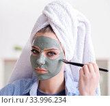 Купить «Woman applying clay mask with brush at home», фото № 33996234, снято 29 января 2018 г. (c) Elnur / Фотобанк Лори