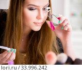 Купить «Woman working on her eyelashes in beauty concept», фото № 33996242, снято 29 января 2018 г. (c) Elnur / Фотобанк Лори