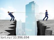 Купить «Boss holding his employee in retention concept», фото № 33996694, снято 3 августа 2020 г. (c) Elnur / Фотобанк Лори