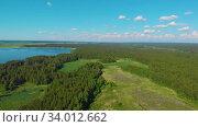 Купить «Aerial view of forest lake», видеоролик № 34012662, снято 5 июня 2020 г. (c) Jan Jack Russo Media / Фотобанк Лори