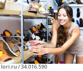 Woman looking after pair of shoes. Стоковое фото, фотограф Яков Филимонов / Фотобанк Лори