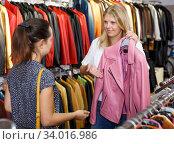 Купить «Two women in leather clothes shop», фото № 34016986, снято 5 сентября 2018 г. (c) Яков Филимонов / Фотобанк Лори
