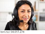 Smiling woman helpline operator with headphones during work. Стоковое фото, фотограф Яков Филимонов / Фотобанк Лори