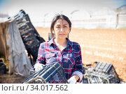 Portrait of an experienced positive female farmer in the backyard. Стоковое фото, фотограф Яков Филимонов / Фотобанк Лори