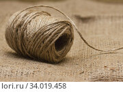 The rope is twisted in a coil. Стоковое фото, фотограф Nataliia Zhekova / Фотобанк Лори