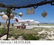 Купить «Beechcraft 1900 aircraft arriving to pick up passengers on Astove Atoll, Seychelles, November 2019.», фото № 34019834, снято 5 июля 2020 г. (c) Nature Picture Library / Фотобанк Лори
