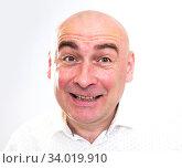 Купить «portrait of bald adult mature man with emotions on white background», фото № 34019910, снято 23 мая 2020 г. (c) Татьяна Яцевич / Фотобанк Лори