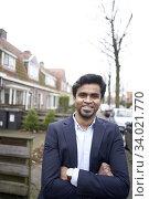 Indian business man in Leeuwarden, Friesland, Netherlands, Europe. Стоковое фото, фотограф Egerland Productions / age Fotostock / Фотобанк Лори