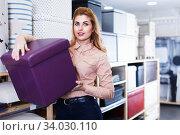 Купить «Girl choosing new comfortable ottoman», фото № 34030110, снято 15 января 2018 г. (c) Яков Филимонов / Фотобанк Лори