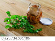 Купить «Assorted marinated mushrooms in glass jar», фото № 34030186, снято 11 июля 2020 г. (c) Яков Филимонов / Фотобанк Лори