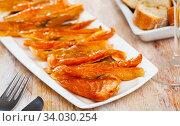 Купить «Close-up of cold smoked salmon belly at plate», фото № 34030254, снято 11 июля 2020 г. (c) Яков Филимонов / Фотобанк Лори