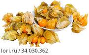 Купить «Closeup of yellow ripe physalis fruit (Physalis peruviana)», фото № 34030362, снято 2 июля 2020 г. (c) Яков Филимонов / Фотобанк Лори