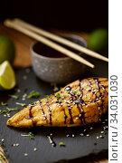 Купить «Grilled chicken fillets on slate plate.», фото № 34031030, снято 22 марта 2019 г. (c) Nataliia Zhekova / Фотобанк Лори
