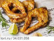 Carp baked in honey mustard sauce. Fried Slices of Big River Fish. Стоковое фото, фотограф Nataliia Zhekova / Фотобанк Лори