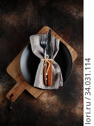Купить «Cutlery on the plate on dark brown background.», фото № 34031114, снято 12 ноября 2019 г. (c) Nataliia Zhekova / Фотобанк Лори