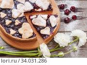 Купить «Homemade cherry pie on rustic background. Delicious homemade cake with cherries and a heart-shaped crust sprinkled with powdered sugar.», фото № 34031286, снято 21 марта 2019 г. (c) Nataliia Zhekova / Фотобанк Лори