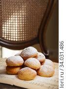 Купить «Homemade profiteroles on the music sheet with notes. Profiteroles (choux à la crème) - French choux pastry balls filled with custard», фото № 34031486, снято 14 марта 2019 г. (c) Nataliia Zhekova / Фотобанк Лори