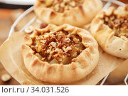 Купить «Caramelized pear rustic pie on wooden background», фото № 34031526, снято 23 марта 2019 г. (c) Nataliia Zhekova / Фотобанк Лори