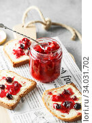 candied fruit jelly. grapefruit marmalade with berry platter. Jar of blood orange jam. Стоковое фото, фотограф Nataliia Zhekova / Фотобанк Лори