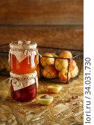 Купить «Apricot jam on a wooden rustic background. Two jars of fruit homemade marmalade. Glass jars with different kinds of fruits.», фото № 34031730, снято 17 июля 2019 г. (c) Nataliia Zhekova / Фотобанк Лори