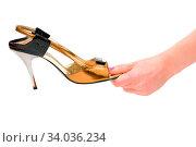 Купить «Hand holding woman shoe isolated on white», фото № 34036234, снято 3 июля 2020 г. (c) easy Fotostock / Фотобанк Лори