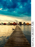 Купить «Sunset lake Bokod with pier and fishing wooden cottages, power plant in background, Hungary», фото № 34037726, снято 15 июля 2020 г. (c) easy Fotostock / Фотобанк Лори