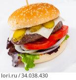 Купить «Image of burger with beef, tomato, cheese, cucumber and lettuce», фото № 34038430, снято 16 июля 2020 г. (c) Яков Филимонов / Фотобанк Лори