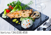 Купить «Tasty fried trout fillet with rice, tomatoes and greens on black plate», фото № 34038458, снято 12 июля 2020 г. (c) Яков Филимонов / Фотобанк Лори