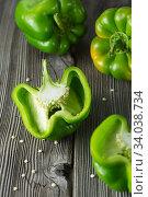 Sweet green pepper on wooden background. Fresh yellow green bell pepper. Стоковое фото, фотограф Nataliia Zhekova / Фотобанк Лори