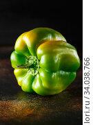Sweet green pepper on dark background. Fresh yellow green bell pepper. Стоковое фото, фотограф Nataliia Zhekova / Фотобанк Лори
