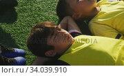 Купить «Soccer kids resting in a sunny day», видеоролик № 34039910, снято 18 октября 2019 г. (c) Wavebreak Media / Фотобанк Лори