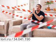 Купить «Young man feeling bored at home in self-isolation concept», фото № 34041190, снято 1 апреля 2020 г. (c) Elnur / Фотобанк Лори