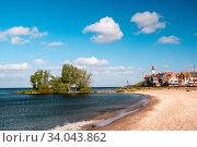 Urk Nehterlands, small fishing village Urk with is colorful lighthouse by the lake Ijsselmeer Netherlands Flevoland Europe. Стоковое фото, фотограф Zoonar.com/Fokke Baarssen / easy Fotostock / Фотобанк Лори