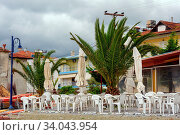 Leptokaria, Pieria, Central Macedonia, Greece - 11th May 2015: Empty outdoor cafe at the beach just prepared for the high season. Стоковое фото, фотограф Zoonar.com/Serghei Starus / easy Fotostock / Фотобанк Лори