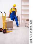 Young male contractor in relocation concept. Стоковое фото, фотограф Elnur / Фотобанк Лори