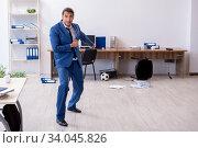 Купить «Young male employee playing football in the office», фото № 34045826, снято 13 сентября 2019 г. (c) Elnur / Фотобанк Лори