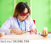 Купить «Woman dentist working on teeth implant», фото № 34046194, снято 11 июня 2018 г. (c) Elnur / Фотобанк Лори