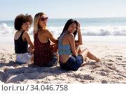 Купить «Multi-ethnic group of female sitting on the beach», фото № 34046758, снято 25 февраля 2020 г. (c) Wavebreak Media / Фотобанк Лори