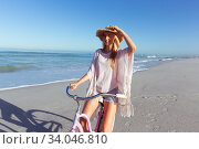 Купить «Caucasian woman spending time seaside and riding a bike», фото № 34046810, снято 25 февраля 2020 г. (c) Wavebreak Media / Фотобанк Лори
